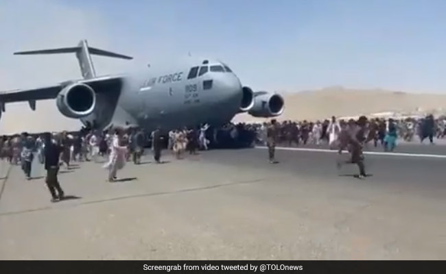 Videos Show Hundreds Swarming Kabul Airport Tarmac To Get On Planes