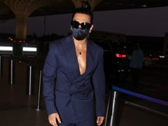Ranveer Singh Suits Up In Style To The Airport Without A Shirt In Sight