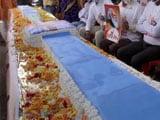 Video : Watch: BJP Workers Cut 71 Feet-Long Vaccine Cake On PM Modi's Birthday Eve