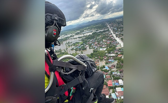 In Thailand, Volunteer Takes To Skies To Drop Supplies To Flood Victims
