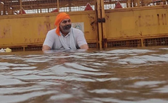 Farmer Leader Rakesh Tikait Stages Protest On Waterlogged Road At Delhi Border