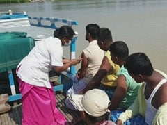 On Boats, Assam Health Workers Take Vaccine To River Islands Amid Floods