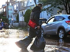 """New Yorkers Resume Life Following """"Unbelievable"""" Rainfall That Killed 8"""