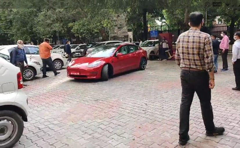 Giridhar Aramane, Secretary, MoRTH took a short test drive in the Tesla Model 3 with a company official