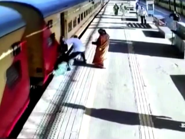 Video : Video: Woman Slips Trying To Board Moving Train, Passengers Rescue Her