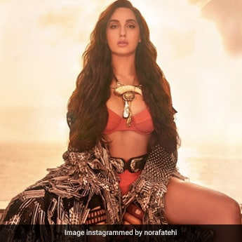 We're All Fired Up At How Fantastic Nora Fatehi Is Looking In An Orange Bikini