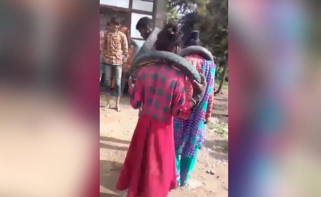 MP Couple Who Eloped, Forced To Dance With Tyres Around Their Necks