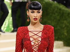 Please Excuse Megan Fox As She Burns Up The Pink Carpet In Her Red Tie-Up Lace Dress