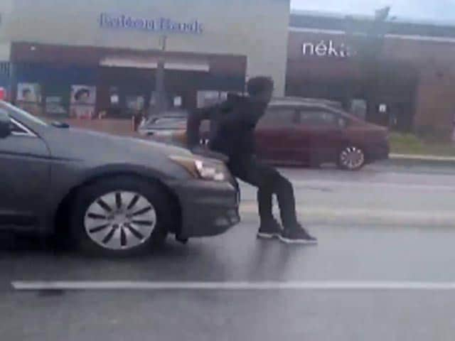 Video : Man Tries To Stop Car, Gets Dragged Around For Several Minutes