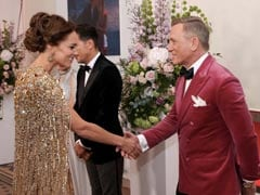 """Kate Middleton Stuns In Gold At """"<i>No Time To Die</i>"""" Premiere"""