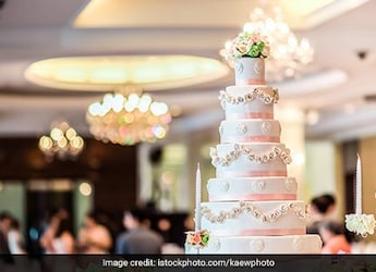 Watch: Wait, What? This Four-Tiered Wedding Cake May Be Fake