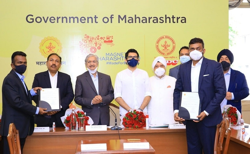 A. Thackeray, Minister for Environment, Peter Kenz, Chairman Causis Group & others at the signing of MoU