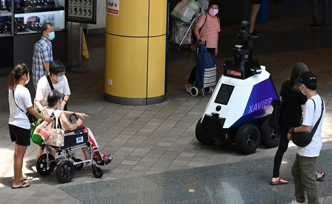 Robots Now Patrol Singapore Streets To Deter 'Undesirable Social Behaviour'