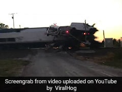 In Horrifying Video, Truck Loaded With Vehicles Gets Hit By High-Speed Train