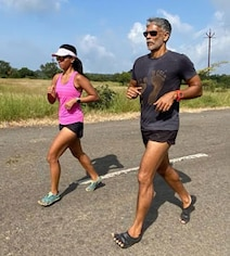 Wondering Who Takes Pics Of Milind And Ankita Running? The Answer Here