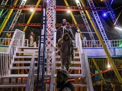 With Machine Guns In Hand, Taliban Fighters Enjoy A Day Off At Amusement Park In Kabul