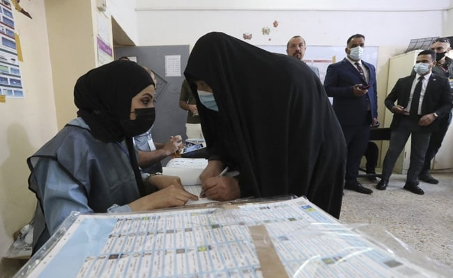 Iraqis Begin Voting In Early Election, Many Expected To Boycott Amid Distrust