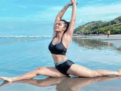 Aashka Goradia Is Busy Sharing Pics From Beach Yoga - One Post At A Time