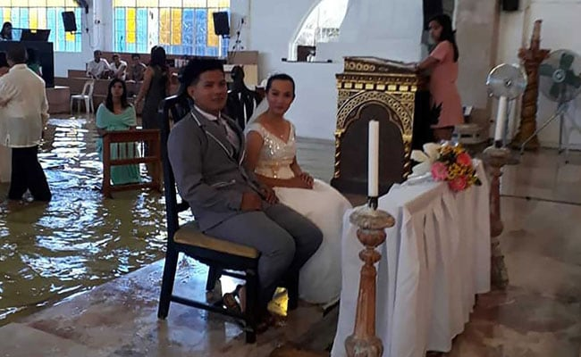 Monsoon Wedding: Bride Wins Hearts By Walking Down Flooded Church Aisle
