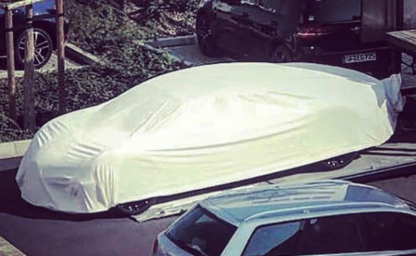 Bugatti sedan spotted under covers
