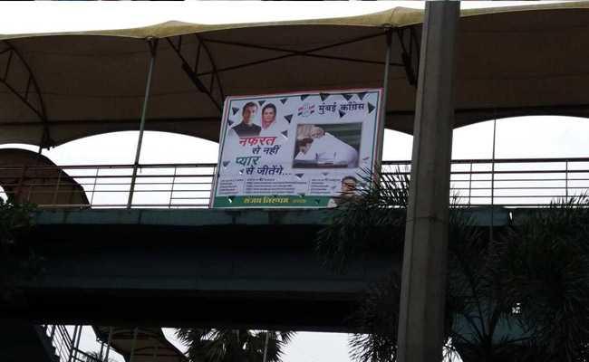 Posters Of Rahul Gandhi Hugging PM Modi In Mumbai