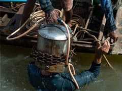 Meet Thailand's 'Indiana Jones' Divers Scour Murky River For Treasure