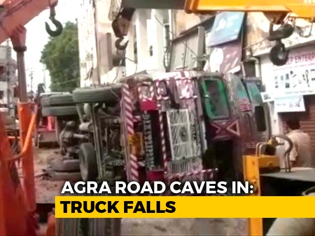 Video : Man Crushed Under Truck, Woman Saved After Road Gives Away In Agra