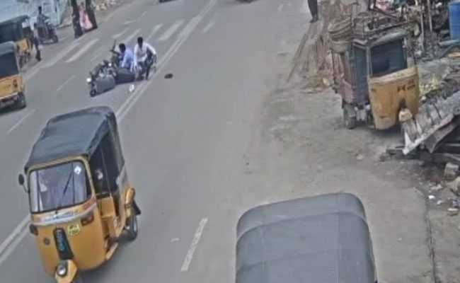 On CCTV, Man Seen Riding Bike On Wrong Side While On Phone, Crashes