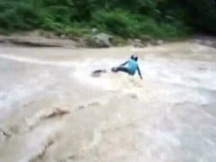Overflowing River, 'Daring' Biker. It Didn't Go His Way. Watch His Rescue