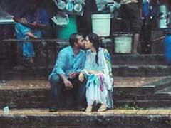 Photographer Clicks Pic Of Couple Kissing In Rain. He Was Thrashed, Fired