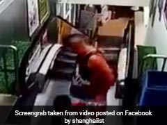 Father, Son Step Off Escalator Just Before It Crashes. Watch Narrow Save