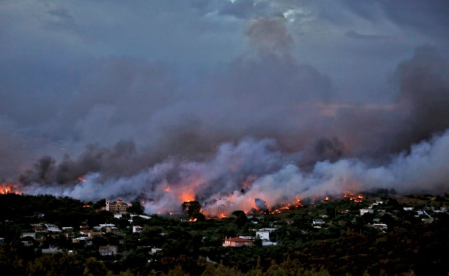 State of emergency in Greece as wildfires force people to flee homes