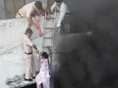 Watch: Delhi Cops Form Human Chain In Dramatic Rescue Of Couple From Fire