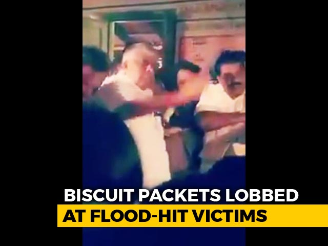 Video : Minister Throws Biscuits At Flood Victims, HD Kumaraswamy Backs Him