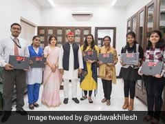 Akhilesh Yadav Hands Out Laptops To Exam Toppers And Criticism To BJP