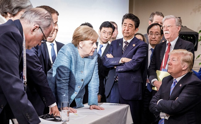 ICYMI: This Pic Of Merkel, Trump From G7 Summit Launched A Thousand Memes