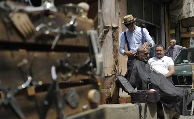 Beirut's Barber-On-A-Bike Offers Curbside Cuts