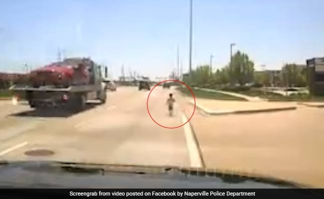 Watch: Police Officer Rescues Toddler Who Ran Into Traffic On Busy Highway