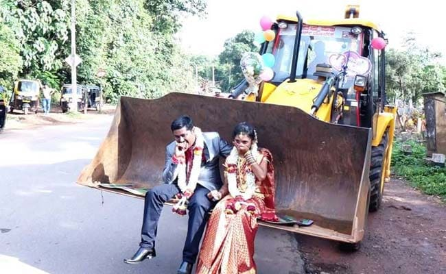 Karnataka Couple's Wedding Procession Features Decked Up JCB Digger