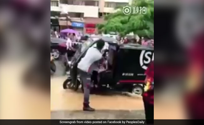 Delivery Man Helps Children Stranded On Flooded Road, Wins Hearts. Watch