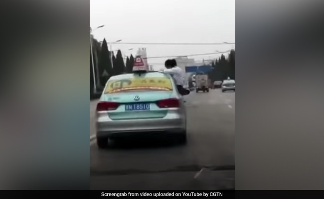 Student Filmed Doing Homework On Roof Of Moving Taxi. Dad Was Driving