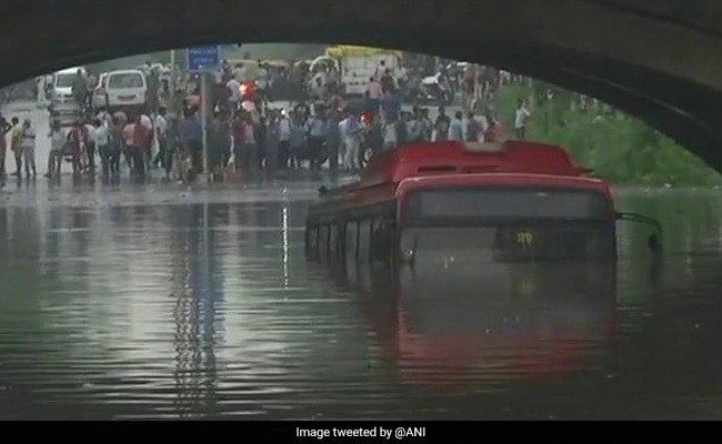Heavy Rain In Delhi Causes Rush Hour Traffic Chaos