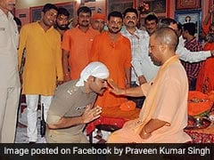 """Feeling Blessed"": Cop Kneels, Folds Hands Before Yogi Adityanath"