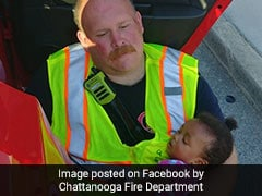 Heartwarming Pic Of Firefighter Cradling Baby After Accident Goes Viral
