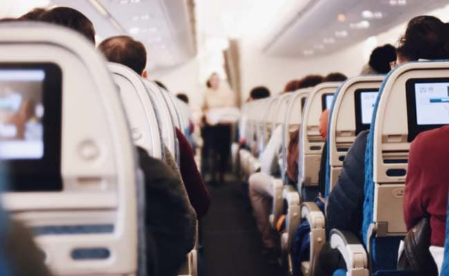Naked Man Tears Down Aisle Upon Plane's Descent, Locked In Bathroom