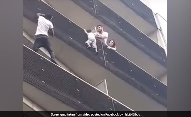 Real-Life 'Spiderman' Scales Building To Save Child Dangling From Balcony