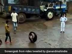 Viral Video Of Boy Rolling Up, Down Road In A Tyre Amazes Anand Mahindra