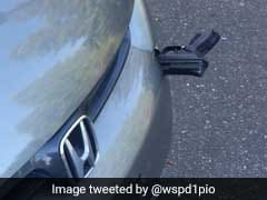 Man Finds Gun Lodged In His Car's Bumper. Cops Look For Answers