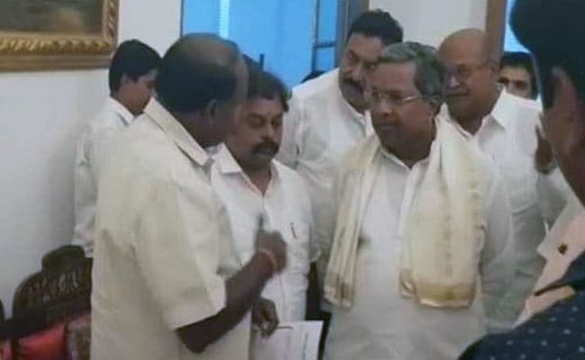 Uneasy Allies? Siddaramaiah, Kumaraswamy Meet Under Governor's Roof