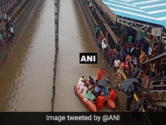 Boats On Flooded Tracks Near Mumbai To Rescue People Stuck In Trains